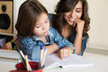 Mother helping child with homework her little Stock Photo