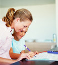 Mother helping her daughter with the homework Stock Photo