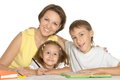 Mother helping her kids doing homework with Royalty Free Stock Images