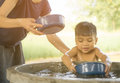 Mother is helping her son taking a bath in village Royalty Free Stock Photo