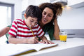 Mother helping son with homework Royalty Free Stock Photo