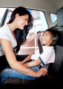 Mother helping to fasten seat belt Royalty Free Stock Photo