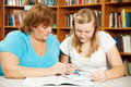 Mother Helps Teen with Homework Stock Photo