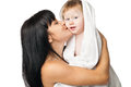 Mother with her baby after bathing in white towel young a Stock Images