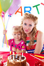 Mother with her baby girl celebrating birthday Royalty Free Stock Photos
