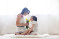 Mother and her child embracing with tenderness and care giving flowers day concept happiness love Stock Image