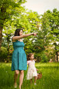image photo : Mother with her child having great time outdoors