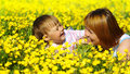 Mother and her child play on meadow Royalty Free Stock Images