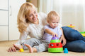 Mother and her child playing with colorful logical Royalty Free Stock Photo