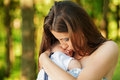 Mother with her child take rest in park Stock Image