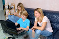 Mother and her children using computer Royalty Free Stock Photo