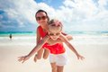 Mother with her cute daughter enjoy the holiday and having fun at beach in mexico Stock Image
