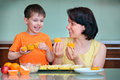 Mother and her cute little boy baking muffins Royalty Free Stock Photo