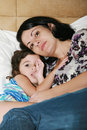 Mother and her daughter on the bed beautiful young Royalty Free Stock Photo