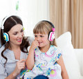 Mother and her daughter listening music Stock Images