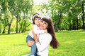 Mother with her daughter outside Stock Photos