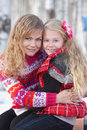 Mother and her daughter in park in winter Stock Image