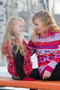 Mother and her daughter in park in winter Royalty Free Stock Images