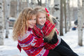 Mother and her daughter in park in winter Stock Photos