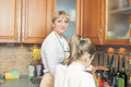 Mother and her daughter together preparing food healthy organic in the kitchen horizontal image composition Royalty Free Stock Images