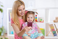Mother and her  little child girl taking selfie on Royalty Free Stock Photo