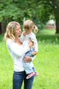 Mother and her little daughter on nature Stock Images