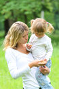 Mother and her little daughter on nature Royalty Free Stock Photo