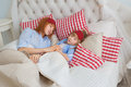 Mother and her little daughter sleep on a bed Royalty Free Stock Photo