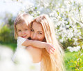 Mother and her little daughter in the spring day happy Royalty Free Stock Image