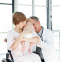 Mother with her newborn baby and doctor Stock Photos