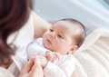 Mother with her newborn baby. Mother is holding her little baby Royalty Free Stock Photo