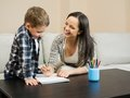 Mother with her son drawing happy young in home interior Stock Images