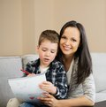 Mother with her son drawing Royalty Free Stock Photo
