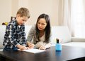 Mother with her son drawing happy young in home interior Stock Photography