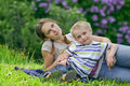 Mother and her Son having rest in spring park Royalty Free Stock Photo