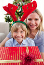 Mother and her son opening Christmas presents Royalty Free Stock Photography