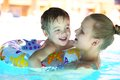 Mother and her son in the outdoor swimming pool little with floating ring rough water of family fun waterpark Royalty Free Stock Photos