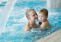 Mother and her son in the swimming pool little with floating ring rough water of family fun waterpark Stock Image