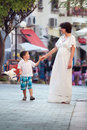 Mother and her three years old son walking in city Stock Image