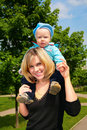 Mother hold child on shoulders outdoor Royalty Free Stock Images