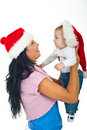 Mother  holding baby at first Christmas Stock Photos
