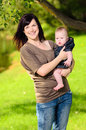 Mother holding baby in park Royalty Free Stock Photos