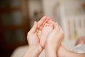 Mother holding baby s foot her hands Royalty Free Stock Photos