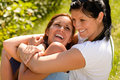 Mother holding daughter in her arms laughing Royalty Free Stock Photos