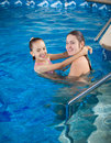 Mother holding daughter on water surface and teaching how to swi portrait of swim Stock Photography