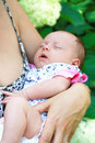 Mother holding newborn sleeping baby Royalty Free Stock Photo