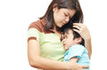 Mother holding son in arm kid painful on white background Stock Images