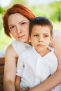 Mother holding son outdoors portrait Royalty Free Stock Images