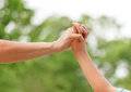 Mother holding son s hand the closeness of and contact Royalty Free Stock Images