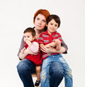 Mother holding two children proud caucasian studio shot over white background Stock Image